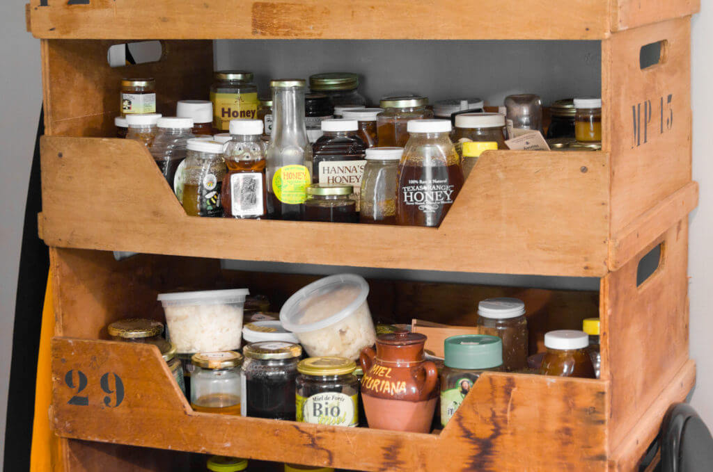 Honey on cabinet shelf